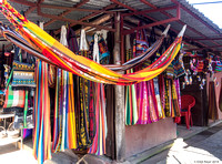 Selling beautifully coloured wraps and hammocks...